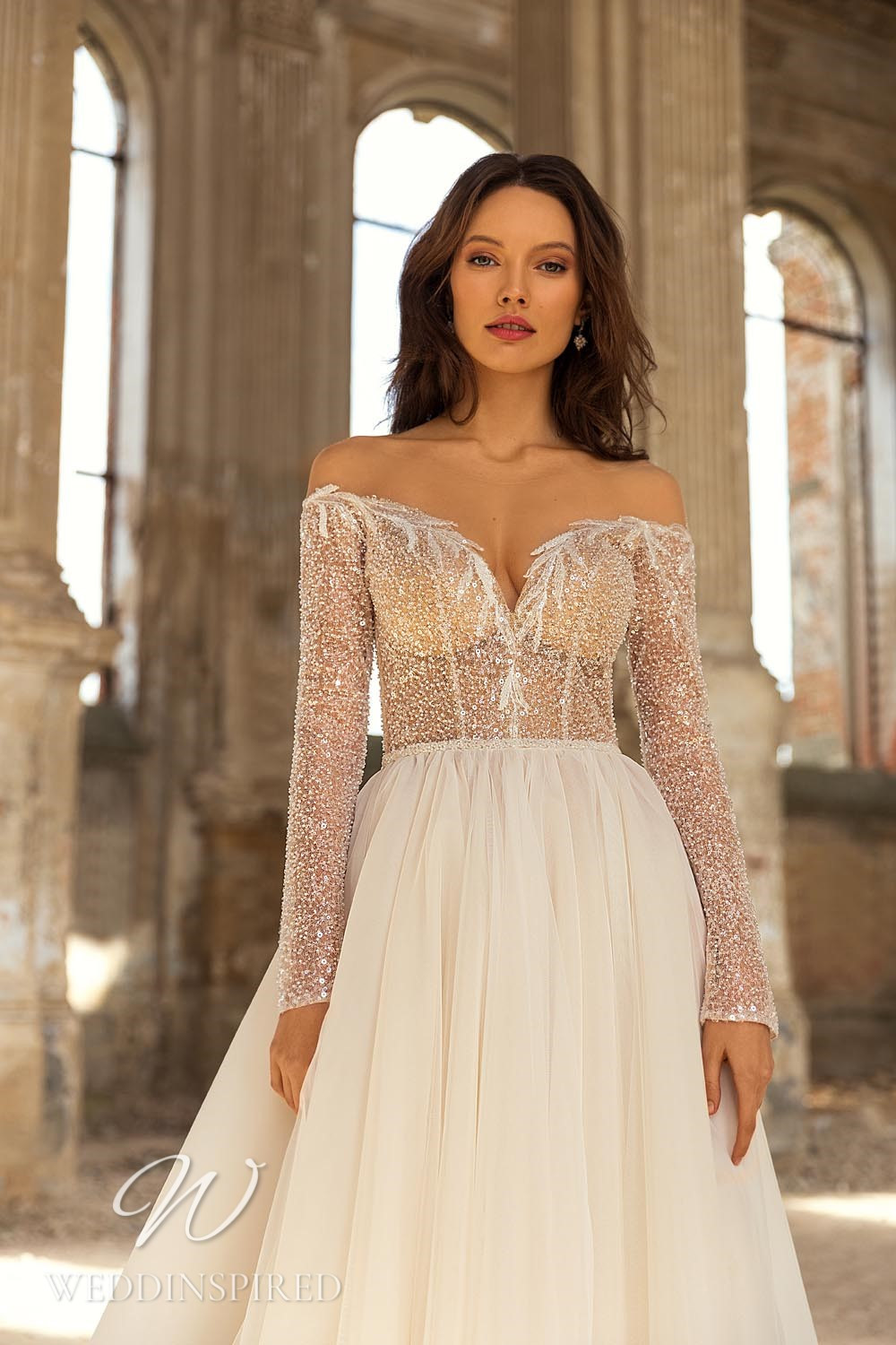 An Eva Lendel 2021 tulle off the shoulder A-line wedding dress with long sleeves