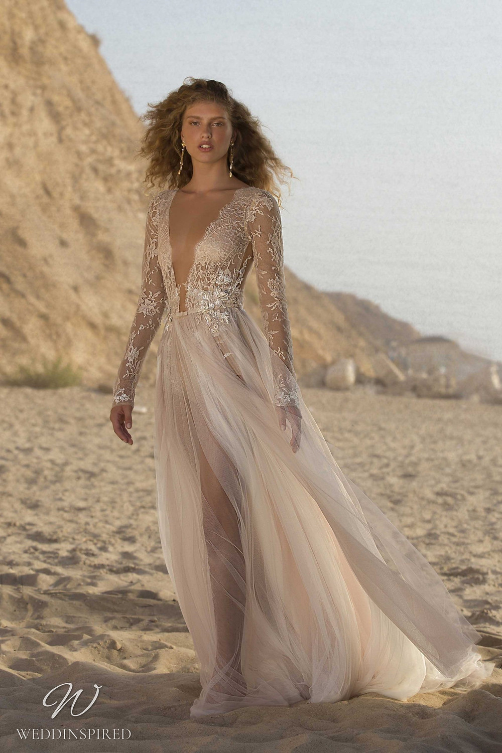 A Muse by Berta lace and tulle blush A-line wedding dress with long sleeves and a v neck