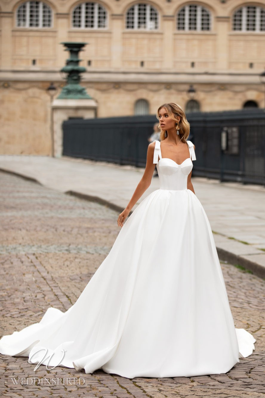 A Milla Nova princess ball gown wedding dress with a sweetheart neckline and straps