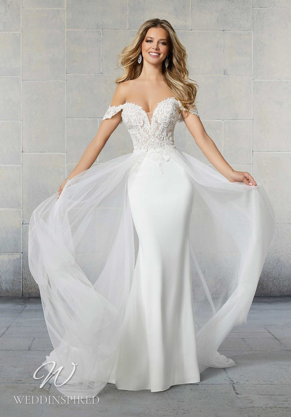 A Madeline Gardner lace and crepe off the shoulder mermaid wedding dress