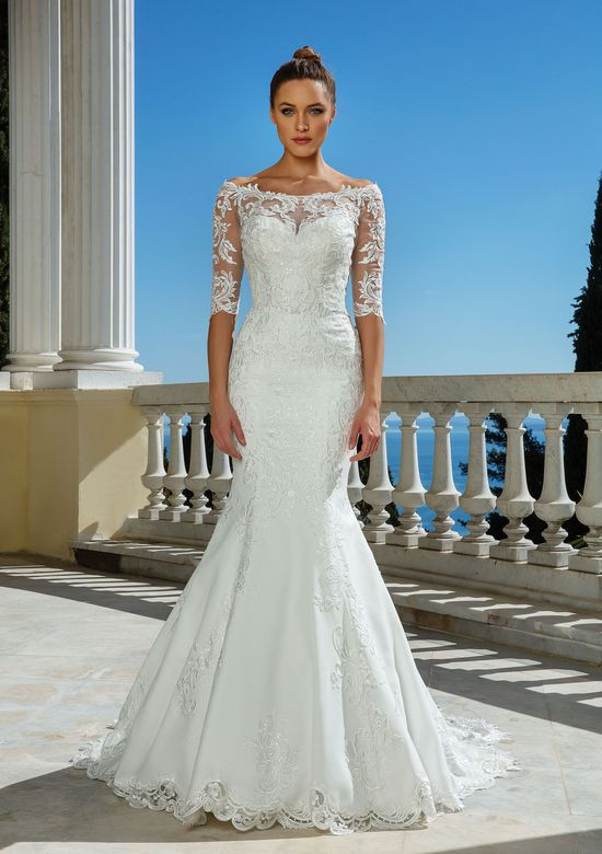 A Justin Alexander 3/4 sleeve, lace, mermaid wedding dress with illusion sleeves