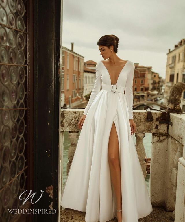 A Rara Avis 2021 silk A-line wedding dress with a high slit, long sleeves and a low v neckline