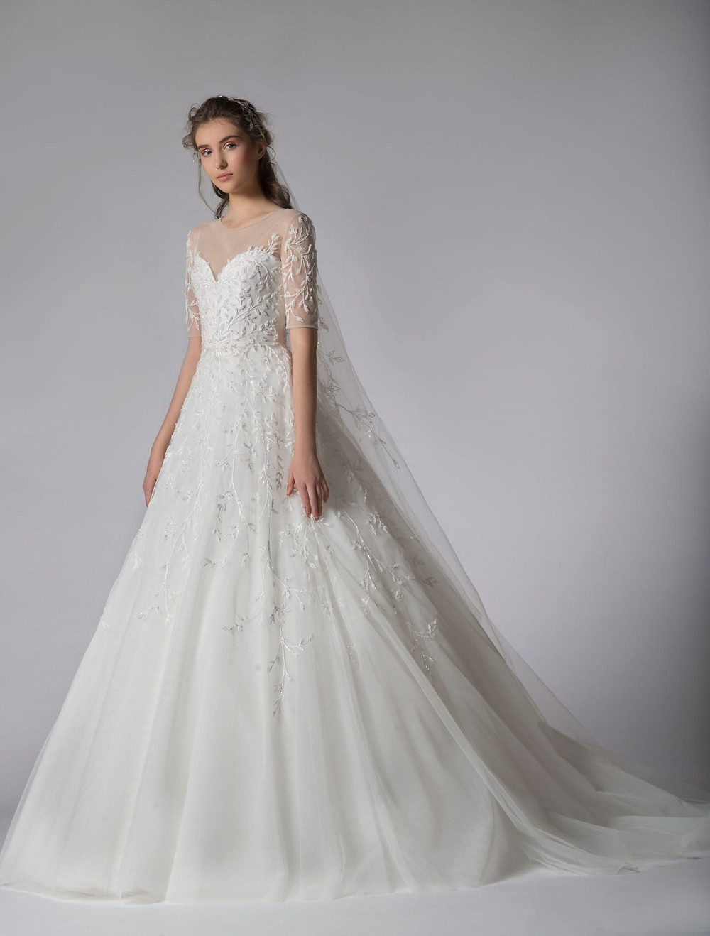 A Georges Hobeika 3/4 sleeve, ball gown wedding dress, with lace and illusion sleeves
