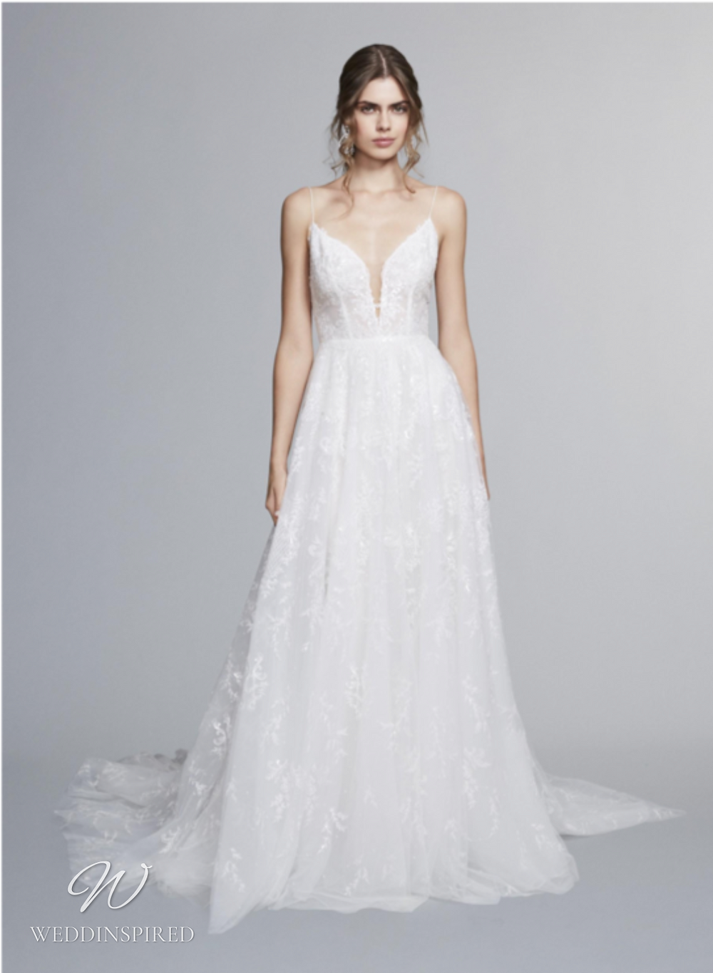 A Marchesa Notte Fall 2021 lace A-line wedding dress with straps and a v neck