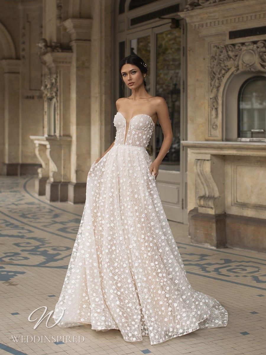 A Pronovias Privée 2021 strapless ivory floral lace A-line wedding dress