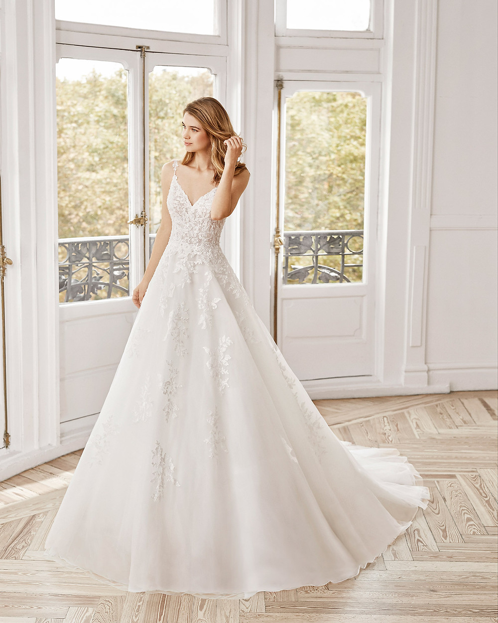 An Aire Barcelona 2020 lace and tulle princess ball gown wedding dress with thin straps