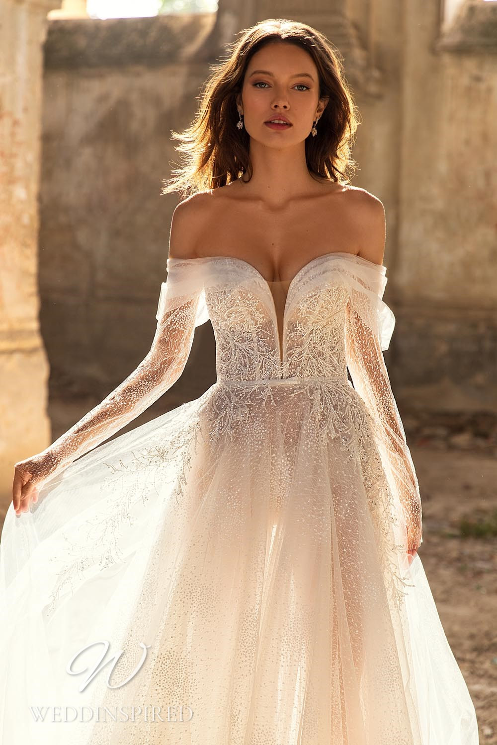 An Eva Lendel 2021 off the shoulder tulle A-line wedding dress with long sleeves