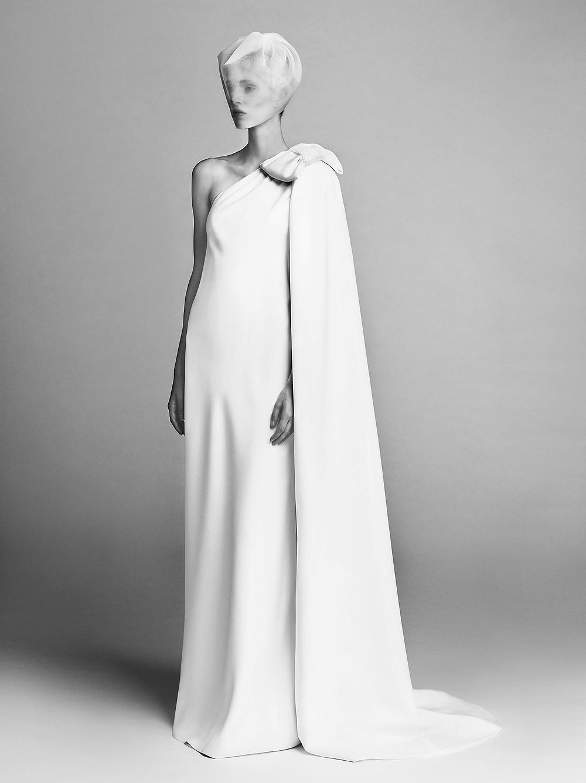 A clean, one shoulder, sheath wedding dress with a bow