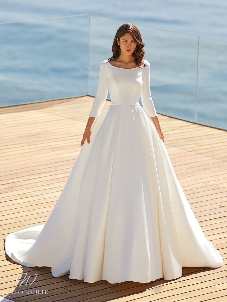 A Pronovias 2021 simple crepe A-line wedding dress with half sleeves and a high neckline