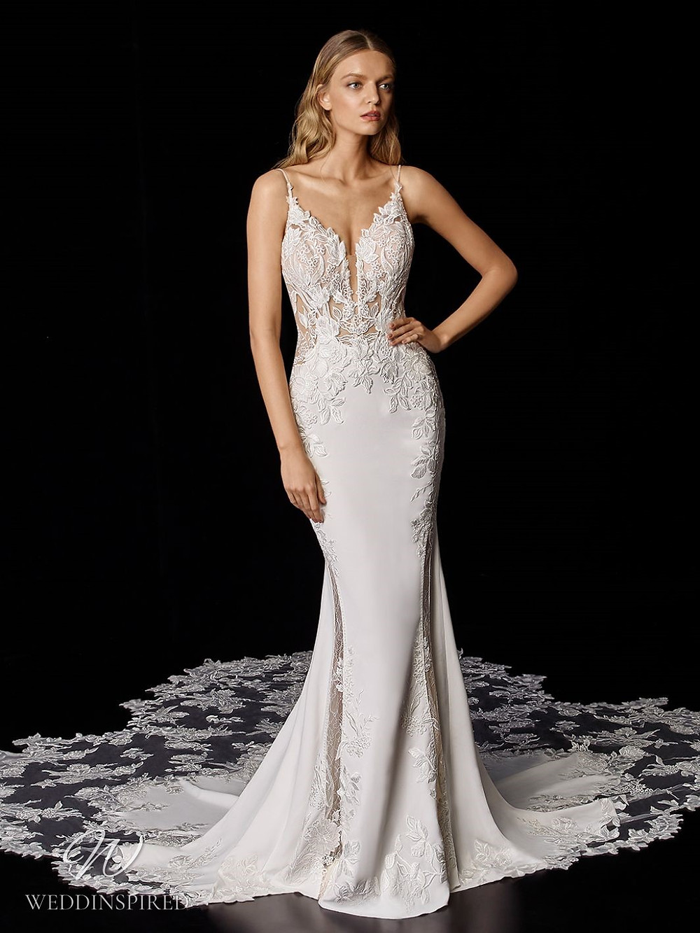 An Enzoani lace and silk column wedding dress with a long lace illusion train