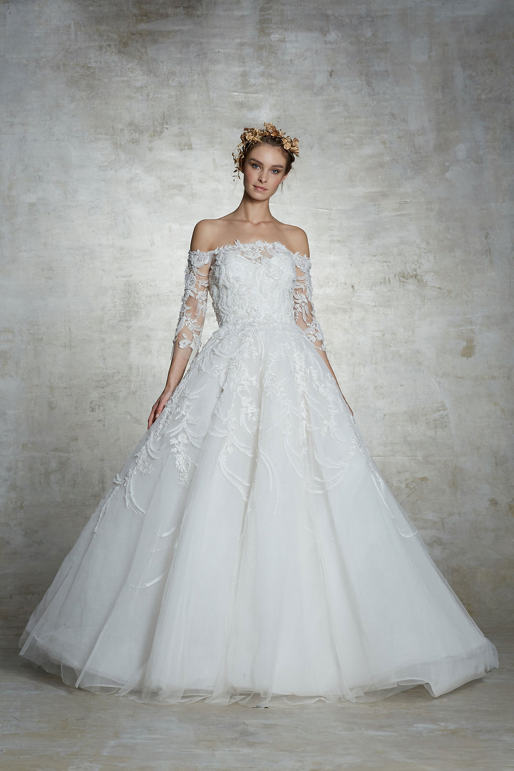 A Marchesa 3/4 sleeve, ball gown wedding dress, with a tulle skirt, a lace top and illusion sleeves