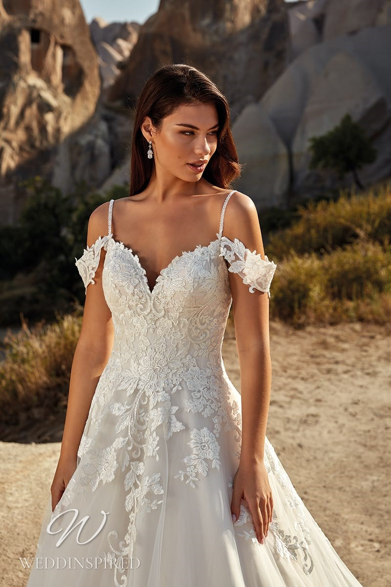 An Eddy K 2021 lace and tulle off the shoulder A-line wedding dress