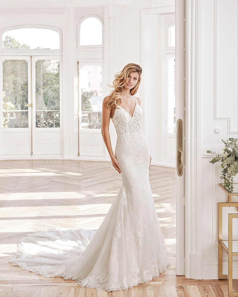 An Aire Barcelona 2020 lace mermaid fit and flare wedding dress with thin straps and a v neckline