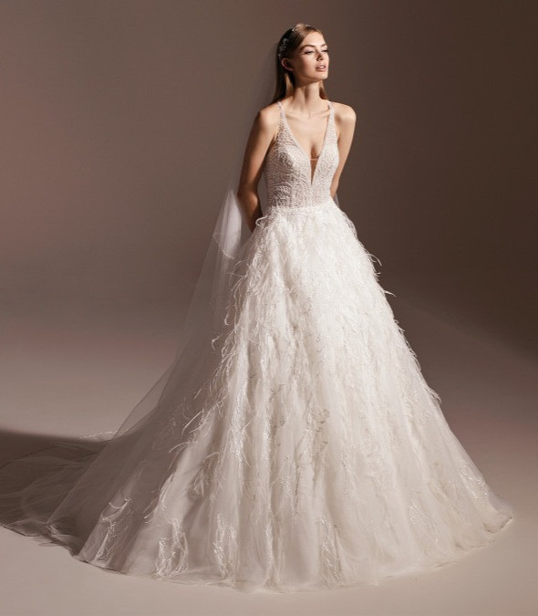 A Pronovias feather and tulle ball gown wedding dress with a v neckline