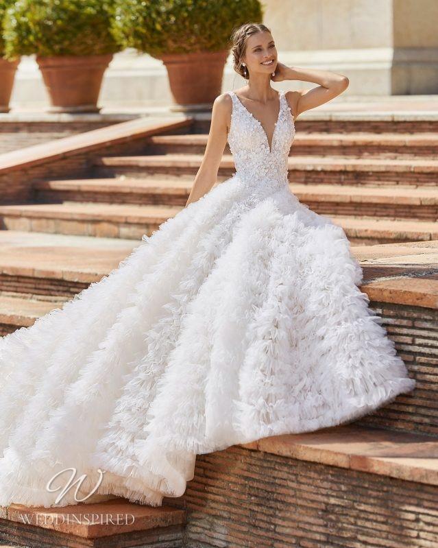 A Rosa Clara 2021 ruffle tulle princess ball gown wedding dress with a v neck