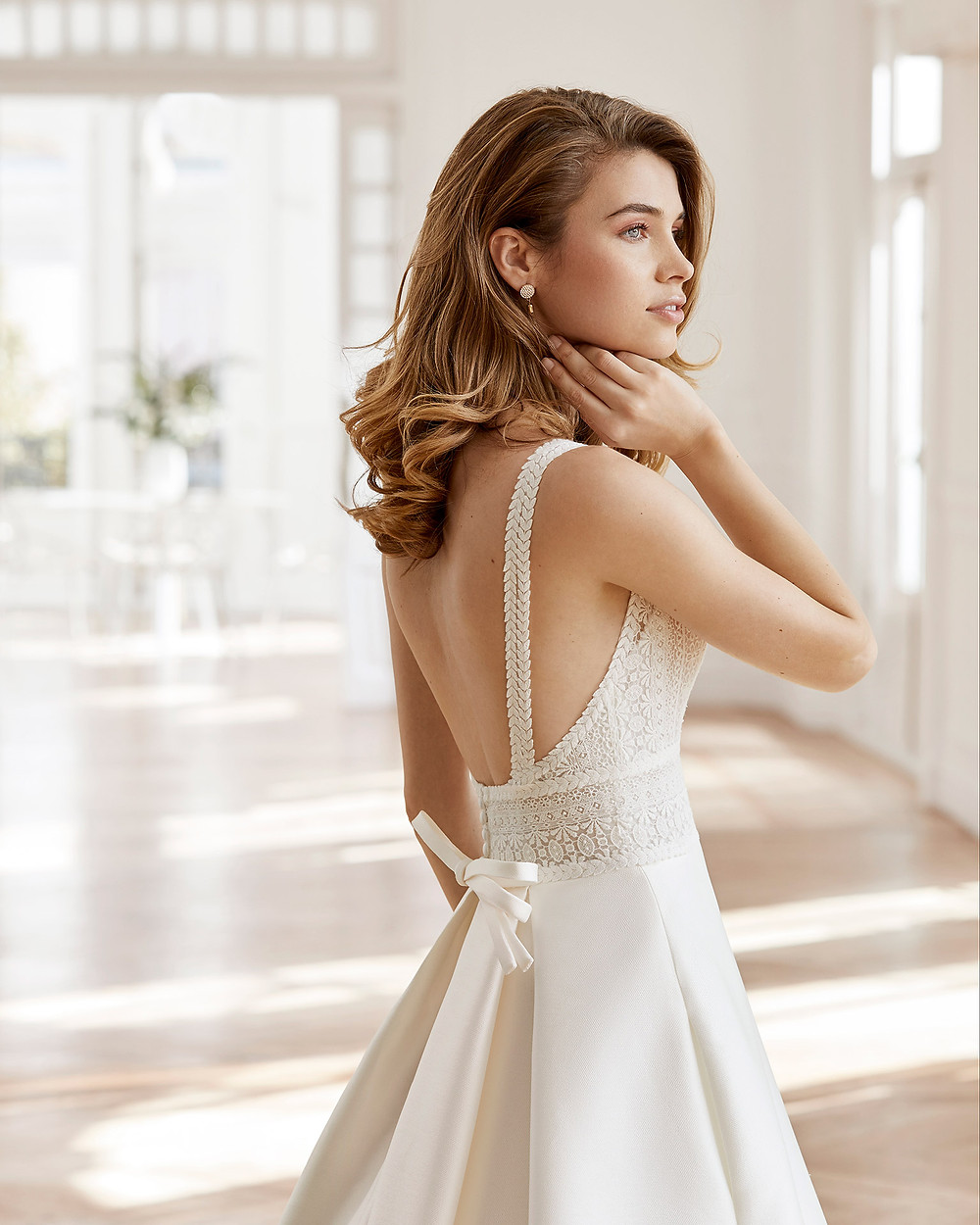 An Aire Barcelona 2020 silk and lace A-line wedding dress with straps and a bow