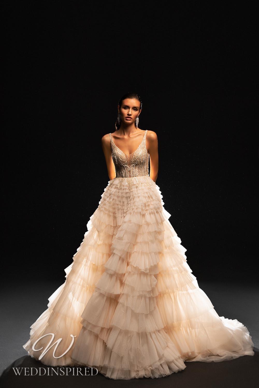 A WONÁ Concept 2021 blush A-line wedding dress with a ruffle skirt
