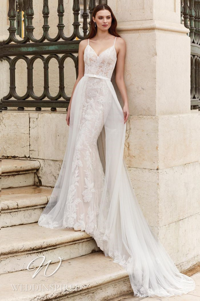 A Justin Alexander 2021 lace mermaid wedding dress with a detachable skirt