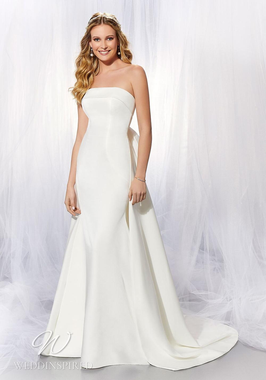 A Madeline Gardner simple strapless satin mermaid wedding dress
