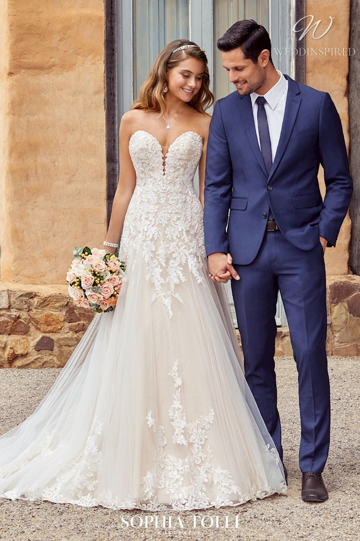 A Sophia Tolli strapless blush lace and tulle A-line wedding dress