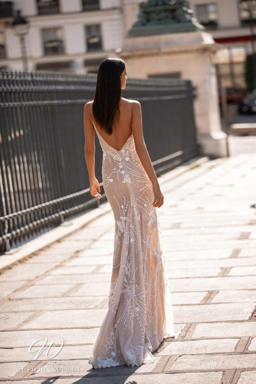 A Milla Nova blush mermaid wedding dress with lace and spaghetti straps