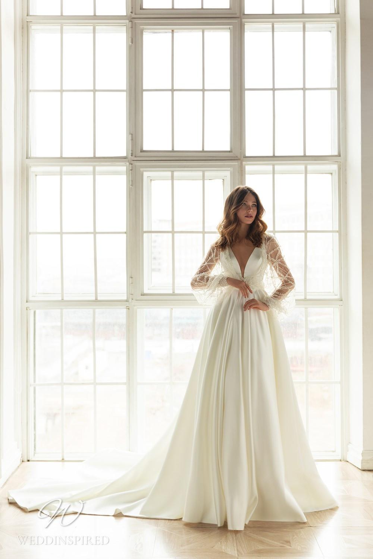 An Eva Lendel 2021 simple silk ball gown wedding dress with a v neckline and a train
