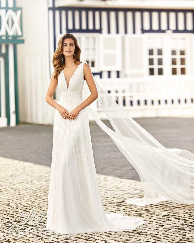 A Rosa Clara 2021 chiffon boho A-line wedding dress with a v neck