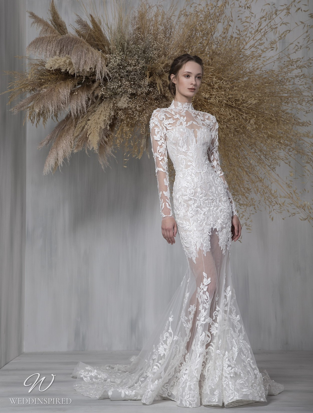 A Tony Ward 2021 lace and mesh mermaid wedding dress with long illusion sleeves and a high neckline