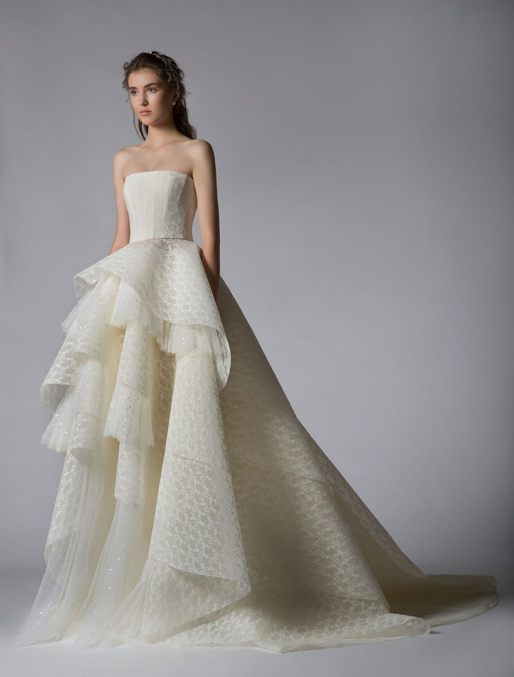 A Georges Hobeika strapless ball gown wedding dress with a layered skirt