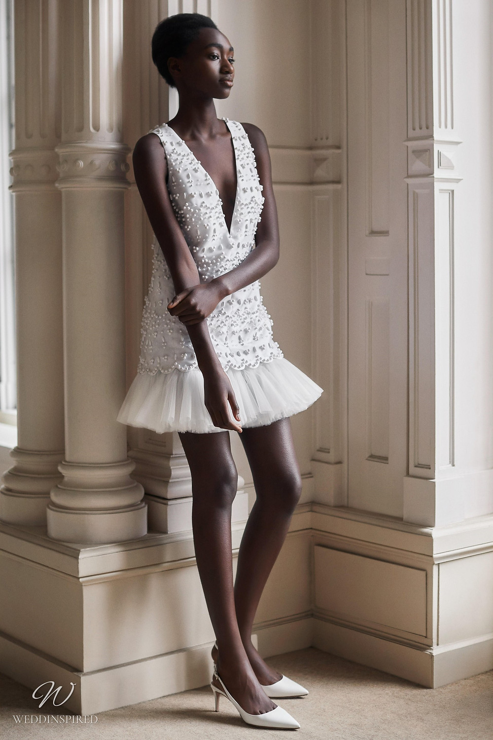 A Viktor & Rolf 2021 short wedding dress with tulle ruffles and beading