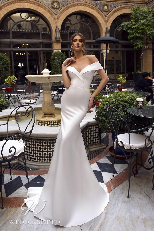 A Maks Mariano off the shoulder satin mermaid wedding dress