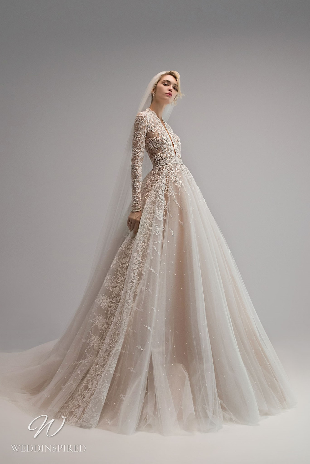 An Ersa Atelier 2021 off white tulle and lace ball gown wedding dress with long sleeves and beading