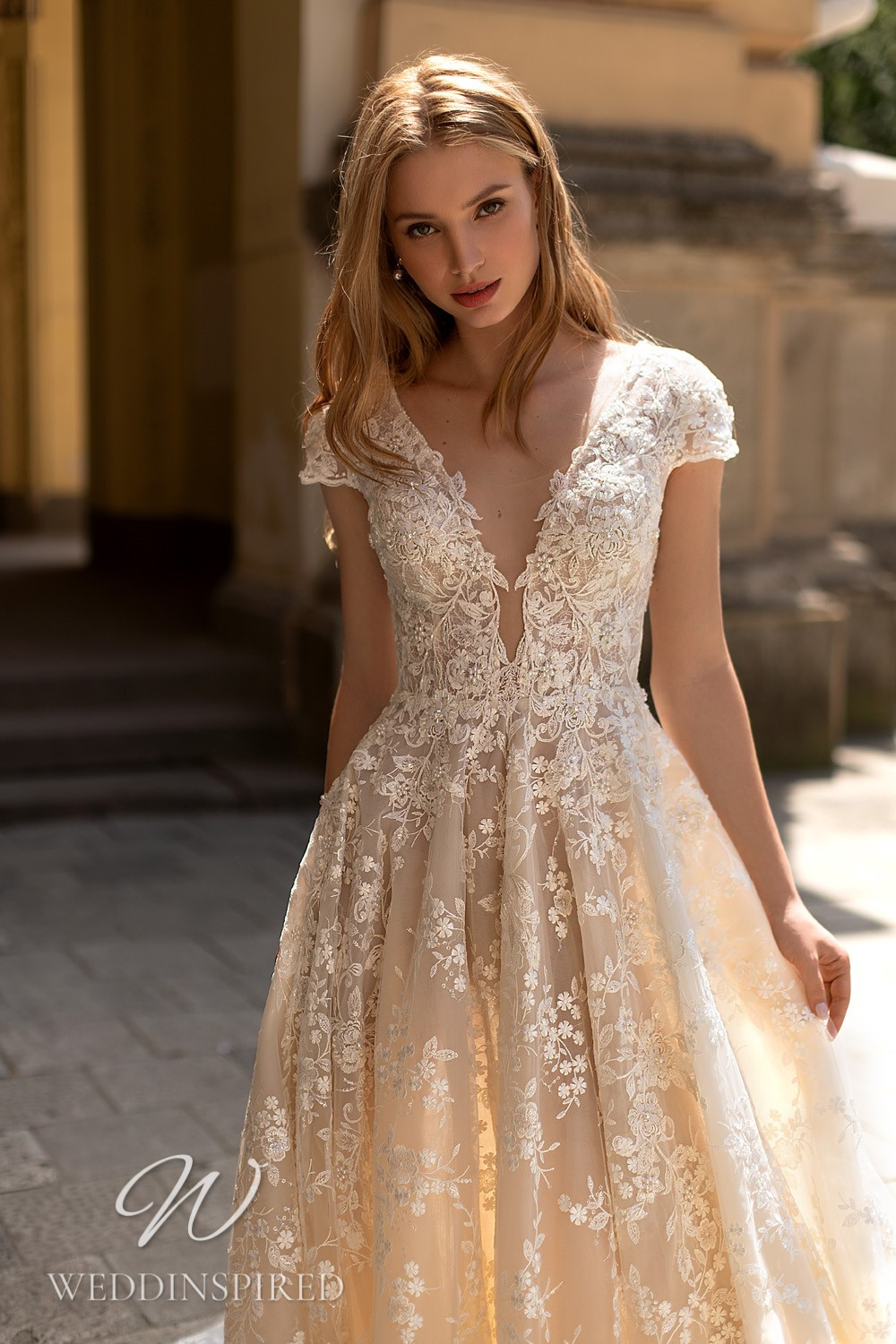 A WONÁ Concept 2021 ivory lace A-line wedding dress with cap sleeves