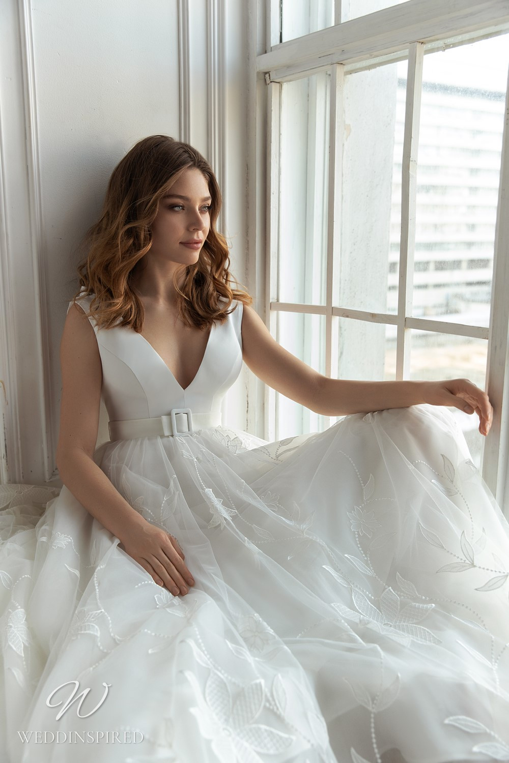 An Eva Lendel 2021 silk and tulle ball gown wedding dress with a v neckline