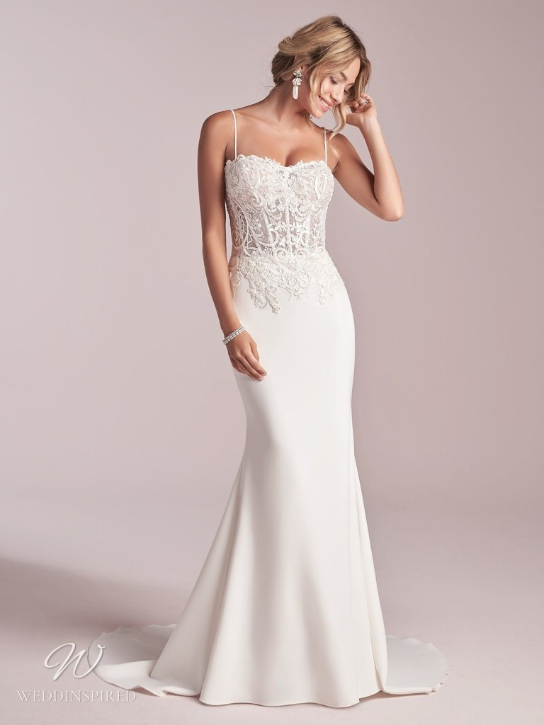 A Rebecca Ingram 2020 lace and crepe mermaid wedding dress with straps