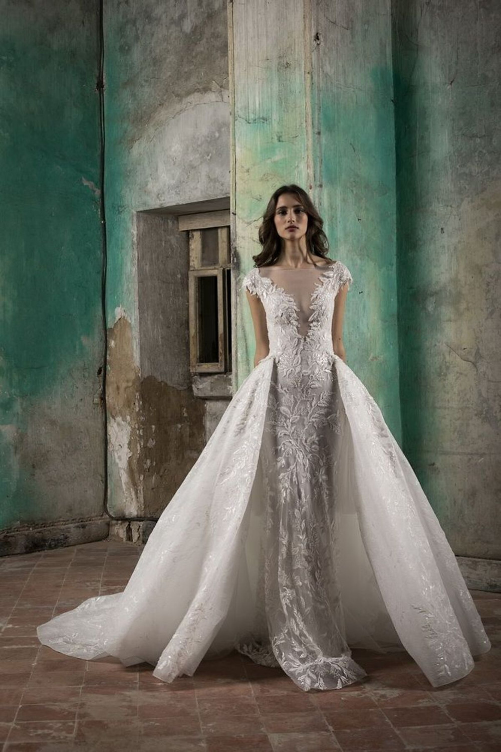 A straight cut lace wedding dress with crystal embroideries featuring a detachable skirt