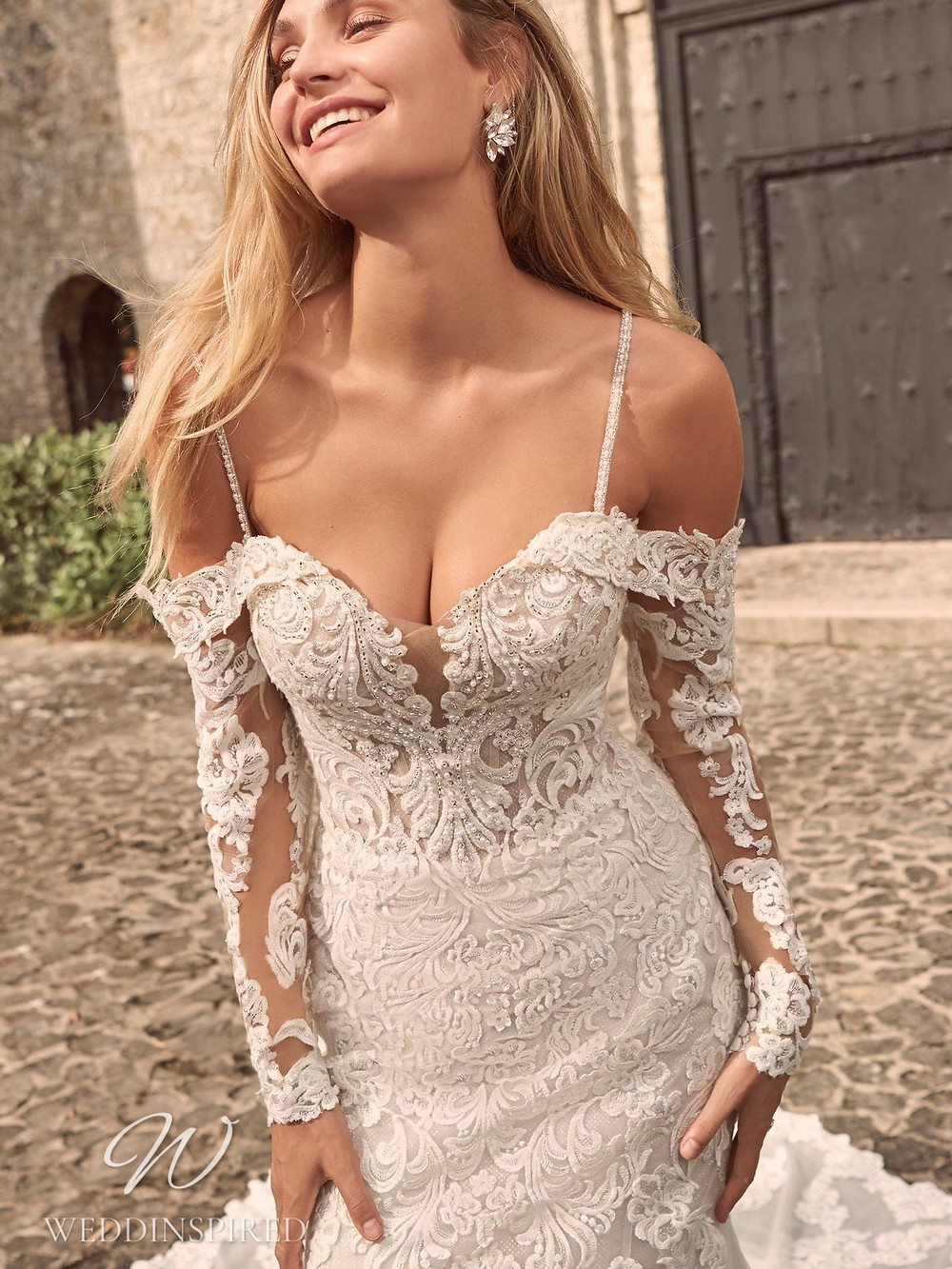 A Maggie Sottero Spring 2021 off the shoulder lace mermaid wedding dress with long sleeves