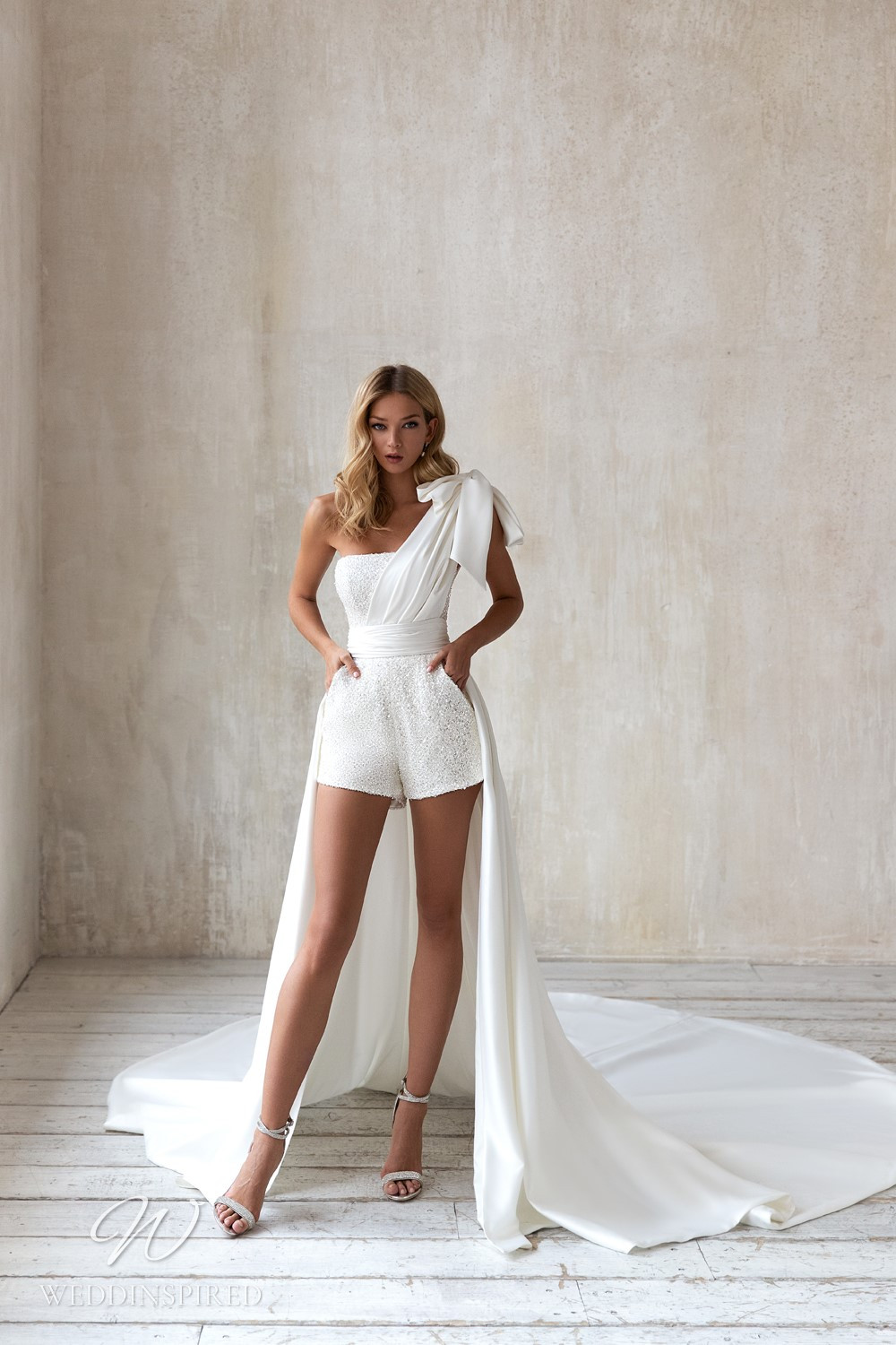 An Eva Lendel 2021 sparkly one shoulder wedding playsuit with a detachable skirt