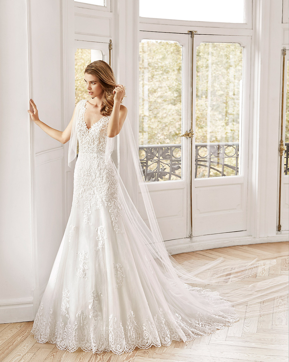 An Aire Barcelona 2020 lace A-line wedding dress with a v neckline