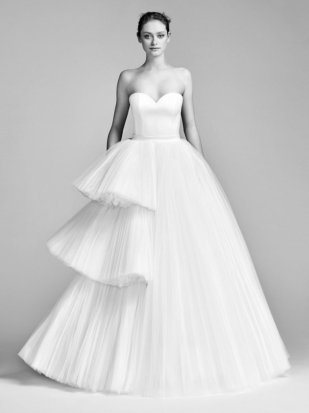 A Viktor & Rolf strapless ball gown wedding dress with a layered tulle skirt and sweetheart neckline