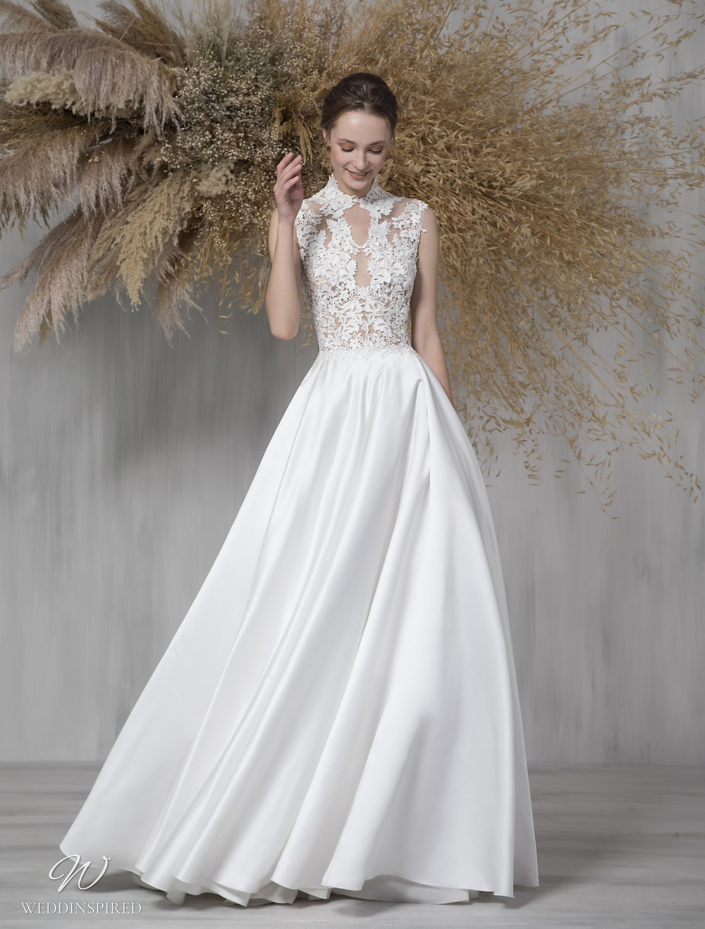 A Tony Ward 2021 lace and satin A-line wedding dress with a collar and a high neckline