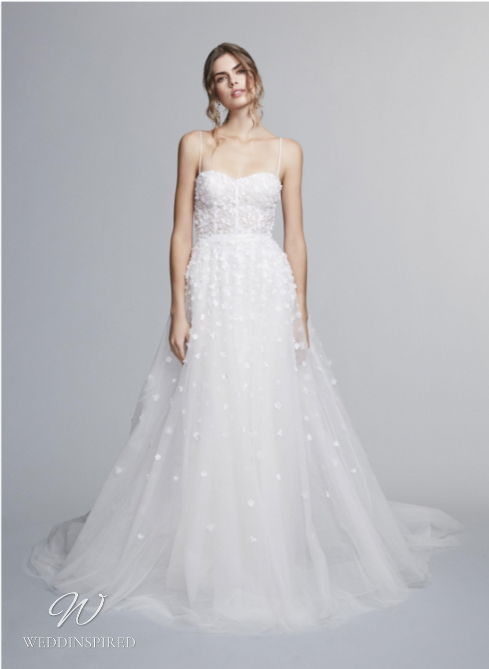 A Marchesa Notte Fall 2021 tulle A-line wedding dress with thin straps and floral detail