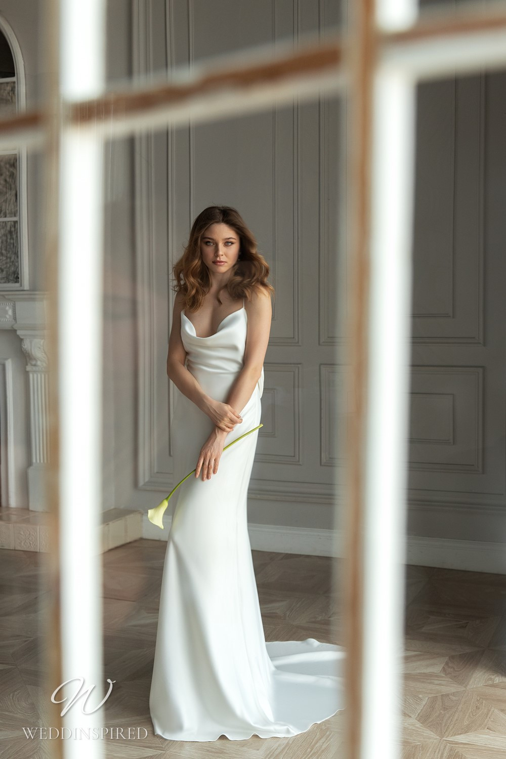 An Eva Lendel 2021 simple silk fitted wedding dress with a cowl neck