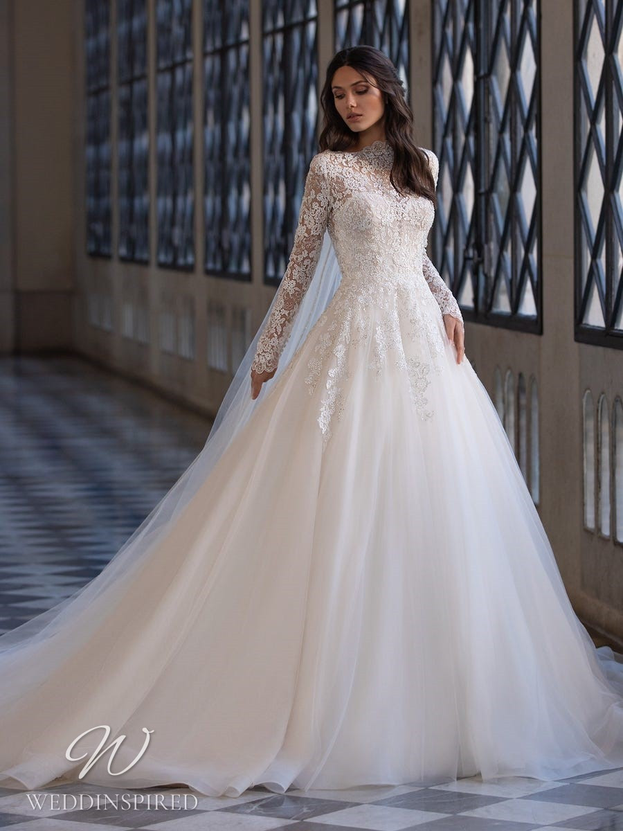 A Pronovias 2021 lace and tulle vintage ball gown wedding dress with long sleeves