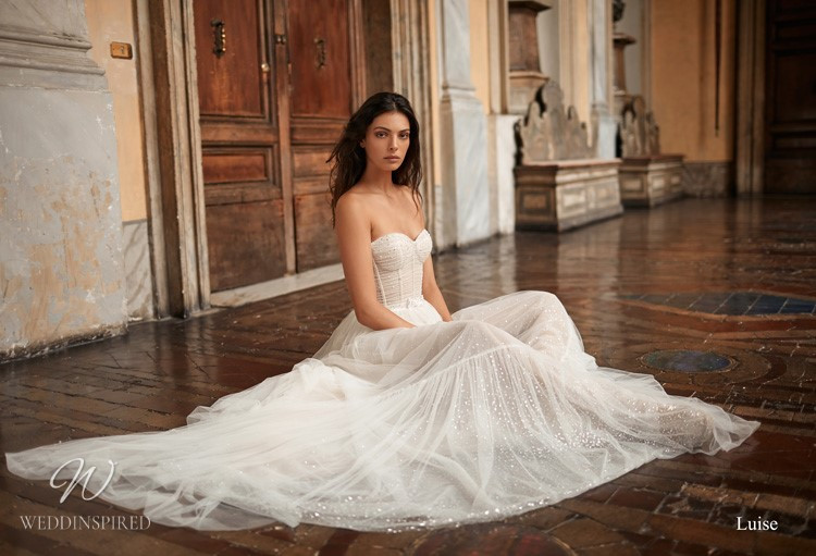 A Gali Karten straples tulle A-line wedding dress with a sweetheart neckline