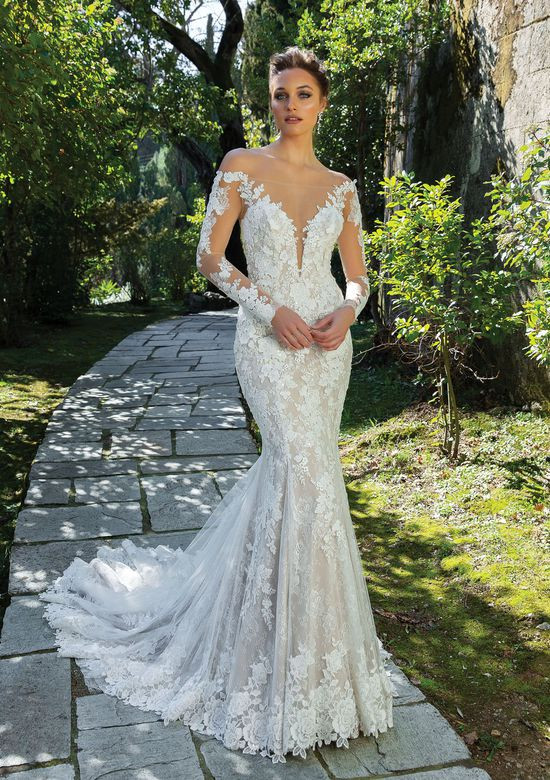 An off the shoulder lace mermaid wedding dress with illusion neckline and sleeves