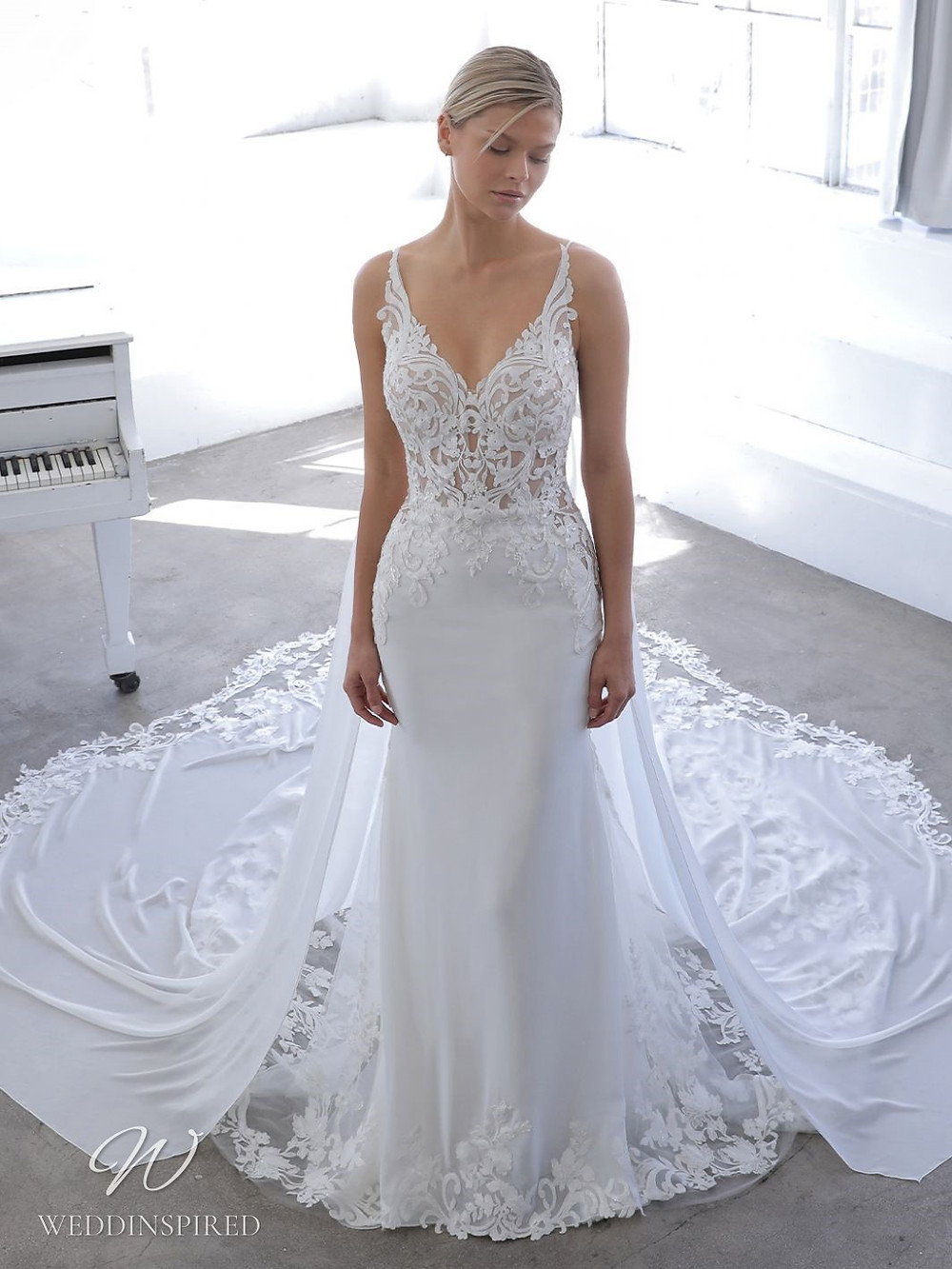 A Blue by Enzoani 2021 lace and crepe mermaid wedding dress with straps and a v neck