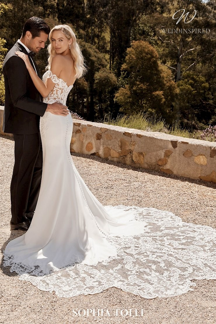 A Sophia Tolli off the shoulder lace mermaid wedding dress with a train