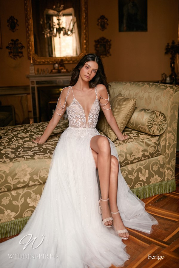 A Gali Karten flowy lace and tulle A-line wedding dress with a train