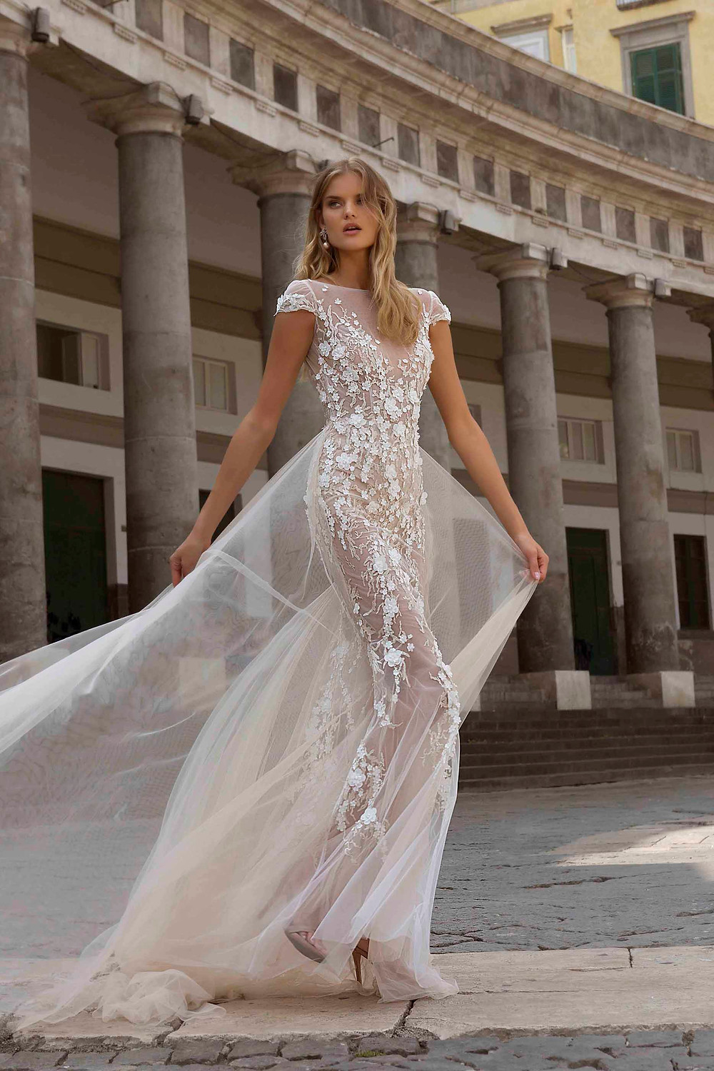 A tulle sheath wedding dress, with cap sleeves, lace and tulle detachable skirt